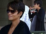 Eating for two! Pregnant Halle Berry nourishes her growing baby bump as she snacks while partying with friends