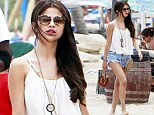 Lured to the sea! Selena Gomez is a summery siren in flowing top and tiny shorts as she hits the beach with gal pal