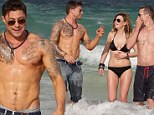 Beach guys: Duncan James and Lee Ryan displayed their buff bodies in Miami on Sunday