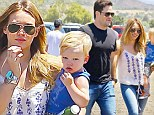 Day on the farm: Hilary Diff and her husband Mike Comrie visited a farm in Thousand Oaks with their son Luca