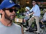Good friends : Hugh Jackman invited Liev Schreiber plus his wife Naomi Watts and their two kids over to his Manhattan apartment in New York on Sunday