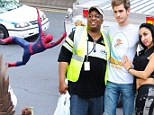 Just hanging around! Andrew Garfield poses with fans as Spider-Man stuntman dangles behind police van on set of sequelJust hanging around! Andrew Garfield poses with fans as Spider-Man stuntman dangles behind police van on set of sequel
