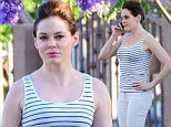 What's black and white all over? Rose McGowan steps out in a simple summer ensemble as she debates on the phone