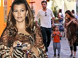 She deserves a breather! Kourtney Kardashian steps out in billowy safari print tunic for sushi dinner with her family