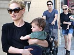 True love! Smiling Anna Paquin and Stephen Moyer show off their cute twins as they enjoy a family day out