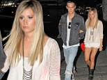 Why so glum? Ashley Tisdale cuts a grumpy figure as she and boyfriend Christopher French go on dinner date