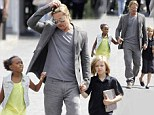 Daddy's girls! Brad Pitt takes daughters Zahara and Shiloh for a stroll in Moscow in a break from promoting new movie