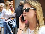 Is that her casual look? Kate Upton hides her voluptuous curves in ripped jeans and knit sweater on errand run in New York