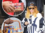 Got the munchies? Rihanna leaves her hotel with boxes of junk food as she continues to enjoy the pleasures of Amsterdam