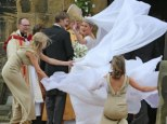 Chelsy tries to tame the bride's dress