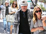 Sweet on each other! Hilary Duff and husband Mike Comrie cosy up and dress alike for an afternoon of shopping
