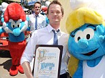Proud Papa and his Smurfs: Neil Patrick Harris hangs out with his blue 'castmates' as they celebrate Global Smurfs Day