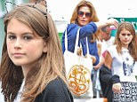 Spot the difference! Cindy Crawford and her daughter Kaia, 11 are the spitting image of each other on family outing
