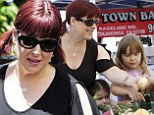 Striving to eat right: Carnie Wilson and her daughters hit a local Farmer's Market on Sunday in Los Angeles
