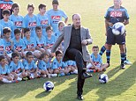 Skills: New Napoli manager Rafael Benitez playing with some children in Italy