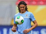 Hitting out: Cavani trains with his Uruguay team-mates in Brazil on Tuesday