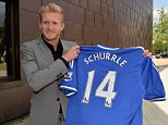 Signed on the dotted line: Andre Schurrle has penned a five-year-deal and will wear the No 14 shirt