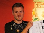 New colours: Simon Mignolet has completed a £9million move to Liverpool from Sunderland