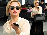 Pictured: Demi Lovato is photographed for the first time at LAX since her father Patrick died