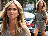 Legs for days: Heidi Klum showed off her amazing limbs as she entered her New York hotel