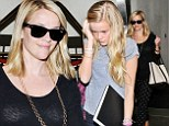 Going dotty: Reese Witherspoon cuts a striking figure in spotted trousers as she arrives at LAX with her lookalike daughter Ava