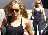 On a fitness mission! Kimberly Stewart wears all black and a serious face as she heads to the gym