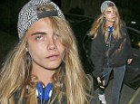 Cara Delevingne looks bleary-eyed as she arrives home after yet another night of partying