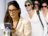 Three's company: Demi Moore joins daughter Rumer and boyfriend Jayson Blair as they jet home to New Mexico