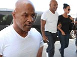 He's still The Champ! Mike Tyson arrives at airport arm-in-arm with wife Lakiha Spicer after his stage show is picked up by HBO