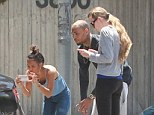 The scene of the crime: Chris and his on and off again girlfriend Karrueche Tran were pictured taking photos of woman's car on the day the incident occurred back in May