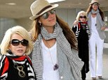 Airport buddies: Brooke Shields, 48, and Joan Rivers, 80, bumped into each other on Tuesday at Los Angeles International Airport