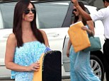 Under wraps! Pregnant Jennifer Love Hewitt coyly covers her baby bump with a large envelope as she steps out in a pretty maxi dress