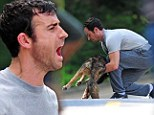 Showing his sensitive side: Justin Theroux breaks down as he films a scene with a deceased dog on the set of his new movie The Leftovers