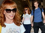 Comfortable in their relationship: Kathy Griffin, 52, and toyboy beau Randy Bick, 33, wear near-matching baggy tracksuit pants for flight home