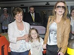 Home time: Geri Halliwell and daughter Bluebell are greeted by Geri's mother Ana Maria at London's Heathrow airport on Thursday