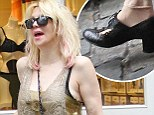 Courtney Love gets ripped in NYC! But for once it is only her shoe that is falling apart