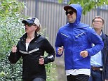 The couple that works out together... Scarlett Johansson and boyfriend Romain Dauric looked perfectly in sync as they jogged around Paris, France, over the weekend