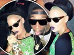 'Mommies need some fun time every now and then!' Amber Rose swigs champagne and feels up Lil Kim on date night with fiance Wiz Khalifa