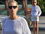 They never end! Karolina Kurkova exposes her supermodel-length slim pins in a tight white miniskirt
