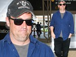 Weight watcher: Matthew Perry arrived on Thursday for a departing flight at Los Angeles International Airport looking full figured