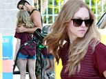 Playful at the pump! Amanda Seyfried gets cosy with a hunky mystery man at the petrol station
