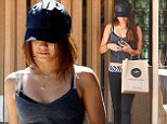 Getting juiced up! Vanessa Hudgens flashes her tummy as she refuels her Pilates body with fresh pressed beverages