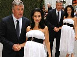 From mourning to electra: Alec Baldwin's pregnant wife Hilaria Thomas shines in billowy white frock at event... after actor's funeral