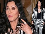Check me out! Cher sports garish patterned suit