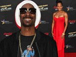 Snoop Lion and Regina King at the BET Experience of Kevin Hart's Let Me Explain