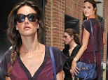 Manhattan chic: Alessandra Ambrosio donned a burgundy jumper as she strolled through New York City on Friday