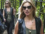 Hold on... I'm coming! Kate Moss makes a last-minute dash to Glastonbury ahead of Rolling Stone headlining gig