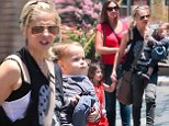 Her little Prinze! Sarah Michelle Gellar pictured with baby Rocky for first time during family outing in Los Angeles