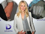 Something to hide? Donna Air keeps her left hand firmly in her pocket after engagement speculation