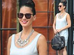 Olivia Munn keeps things classy in a simple pale blue shift dress and ornate necklace